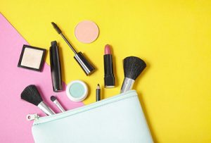 White make up bag with products out