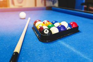 Billiard table felt, balls, and cue