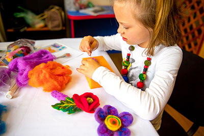 Caption: a young girl with felt decorations