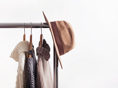 Felt hat and clothes hanged