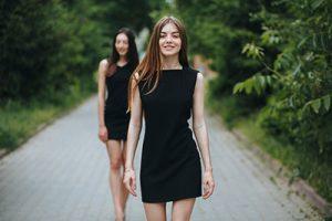 Girls wearing black dresses