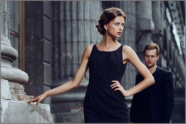 A stylish woman wearing a black dress