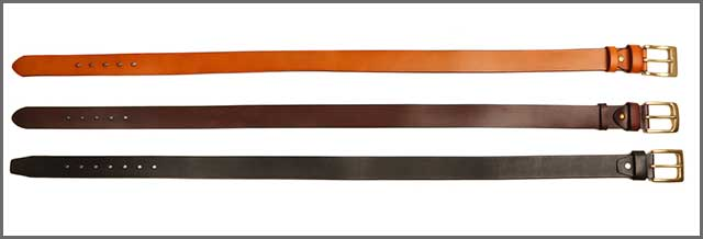 Belts in various colors on white background