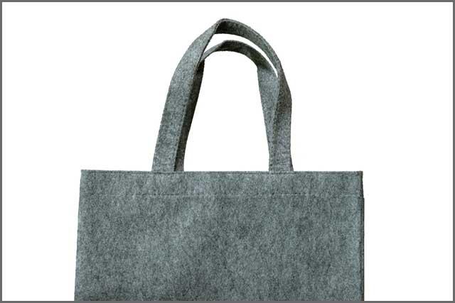 Simple felt bag with straps shown