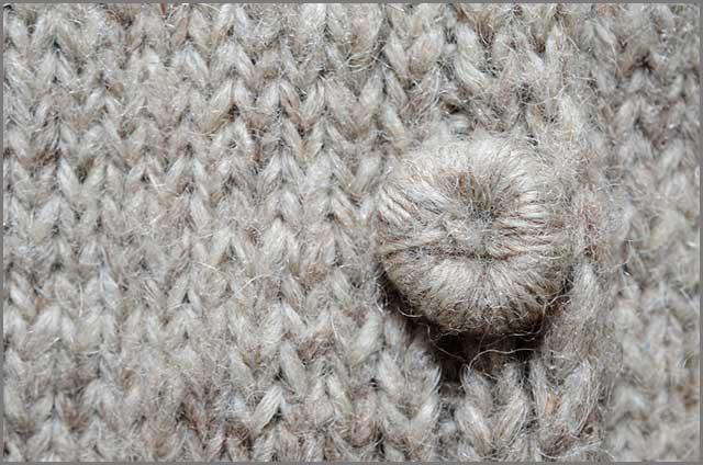Gray felt sweater with a handmade button