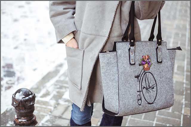 A gray felt bag with a reinforced bottom