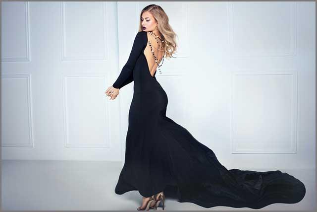 A blonde women wearing the long black dress